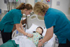 Binghamton university nursing students performing simulation training